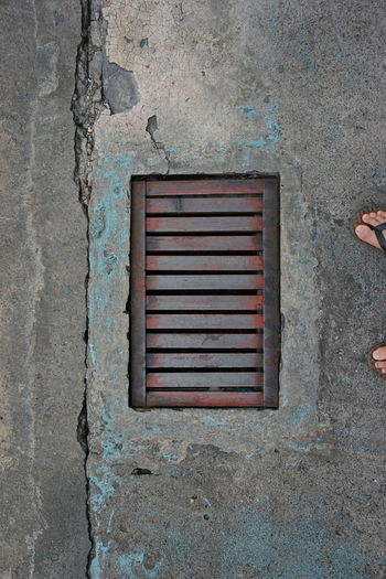 Close-up Architecture Building Exterior Built Structure Metal Grate Weathered Rough Peeling Off Sewage Manhole  Sewer Deterioration Water Pollution Bark Gutter Grate Bad Condition Run-down Damaged Peeled Civilization Textured  Worn Out Rugged Obsolete Shipwreck Ruined Rusty Abandoned Drain