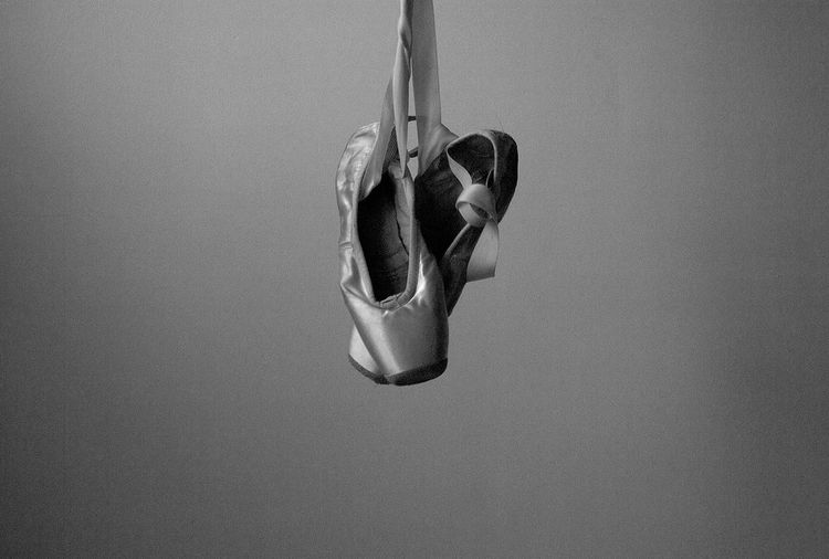 Ballet shoes on wall