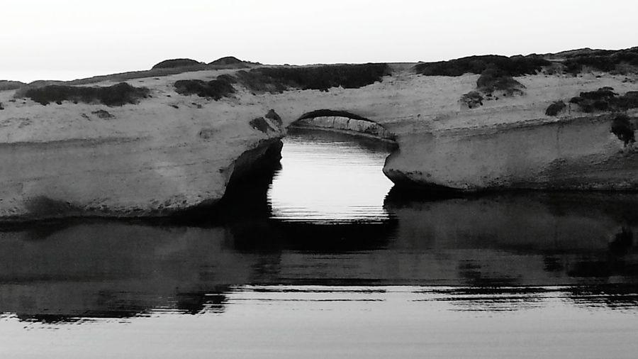 Nature's Diversities S'archittu Sardegna S'archittu Black And White Black & White Sea Arch Reflection