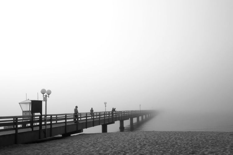 Pier over sea in foggy weather