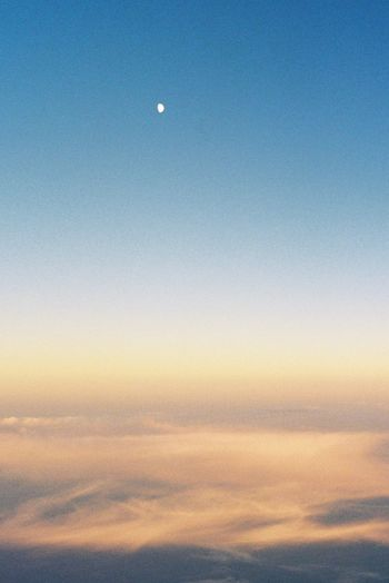 The moon as a white dot. Film Photography Analogue Photography Filmisnotdead 35mm Film Sky Moon Beauty In Nature Scenics - Nature Tranquility Tranquil Scene Nature Crescent Cloud - Sky Sunset Astronomy Dusk