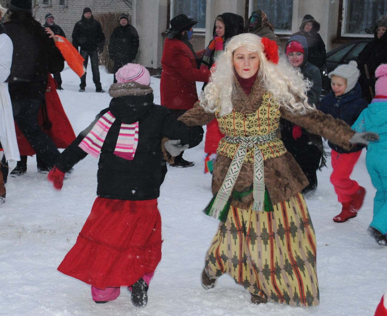real people, celebration, leisure activity, street, fun, lifestyles, enjoyment, full length, dancing, winter, women, performance, snow, arts culture and entertainment, togetherness, architecture, happiness, outdoors, day, men, warm clothing, adult, people