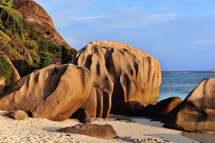 Source d'Argent, La Digue, Seychelles Beach Beauty In Nature Blue Cliff Day Destination Eroded Geology Horizon Over Water Island Nature Non-urban Scene Outdoors Remote Rock Rock Formation Scenics Sea Seychelles Sky Solitude Tranquility Travel Traveling Water