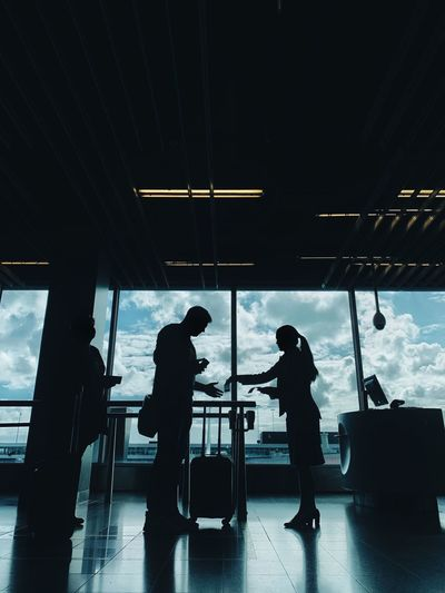 Aircraft Traveling Flight Attendant Airport Real People Silhouette Lifestyles Men Indoors  Transportation People Women Built Structure Ceiling Mode Of Transportation Travel Architecture