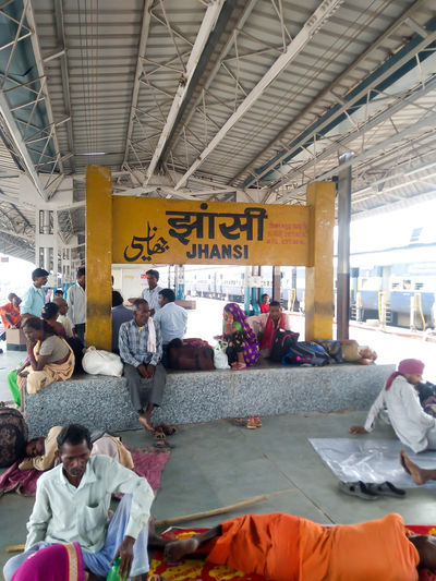 Group of people waiting for sale at railroad station