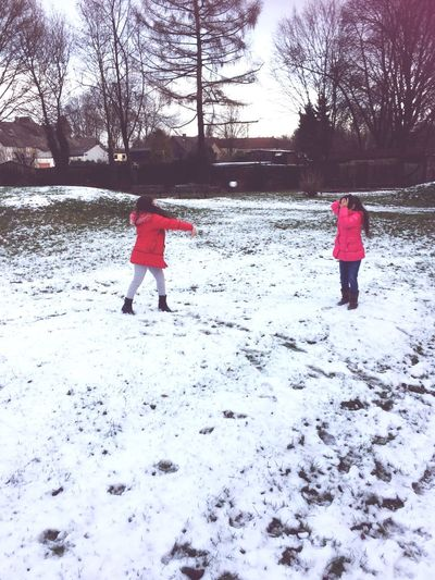 Winter Childhood Cold Temperature Snow Two People Real People Child Warm Clothing Playing Togetherness