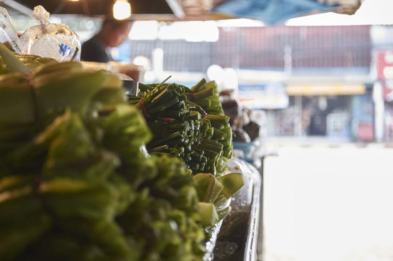 Leaf vegetables at market stall for sale