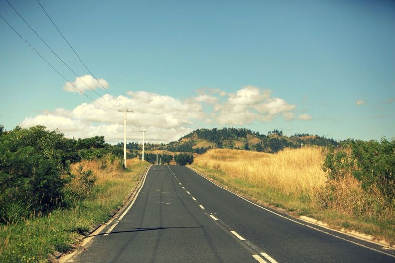 ROAD PASSING THROUGH LANDSCAPE