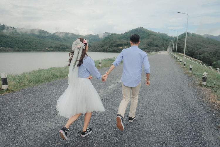 wedding Full Length Two People Real People Love Rear View Women Adult Togetherness Emotion Positive Emotion Nature Wedding Couple - Relationship Men Walking Bonding Bride People Newlywed Outdoors Road Wedding Photography