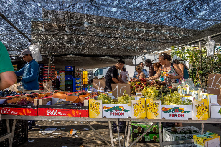Retail  Food And Drink Group Of People Food Business Market Men Women Adult Market Stall Box Freshness People Real People Selling Occupation Container Day Healthy Eating Wellbeing Buying Roquetas De Mar Street Market SPAIN Almería
