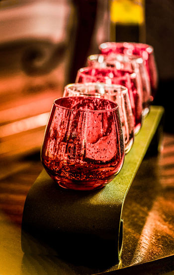 Close-up of red drinking glasses on table