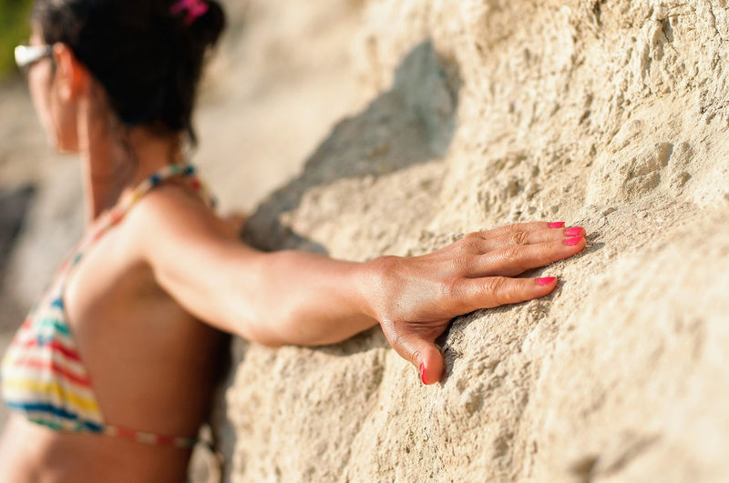 Leaning against the rocks. Heath Sunny Touch Adventure Arm Close-up Connection Connection With Nature Hand Leaning Leisure Activity Rock - Object Rock Climbing Stretch Stretched Arm Stretching Stretching Out Sunbath Sunbathing Warmth