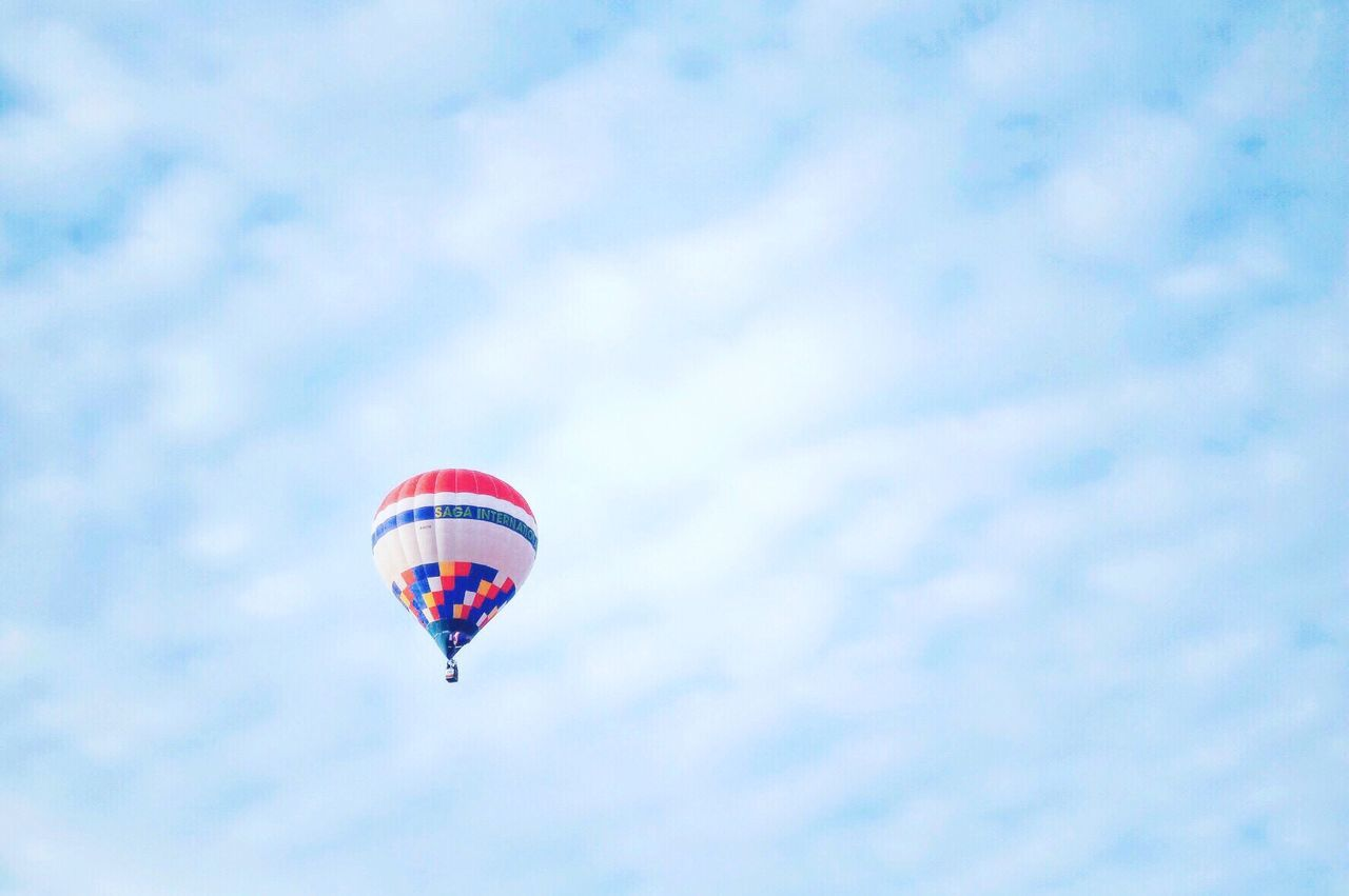mid-air, flying, sky, cloud - sky, adventure, day, parachute, low angle view, outdoors, nature, extreme sports, beauty in nature, no people, hot air balloon