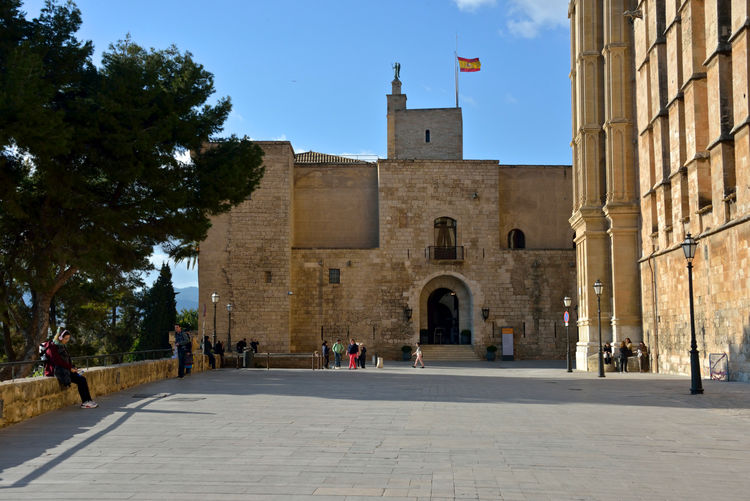 view of Royal Palace in Palma di Maiorca Architecture Built Structure Building Exterior City Incidental People The Past Place Of Worship Travel Destinations Outdoors Palma De Mallorca Royal Palace Square Building History Travel Street Cityscape Highlights