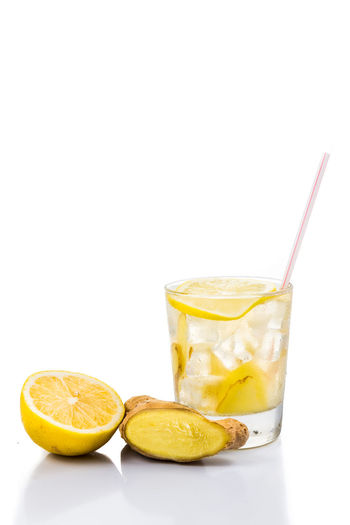 Cold icy refreshing and healthy ginger drinks Ginger Tea Tea Citrus Fruit Cocktail Drink Drinking Glass Drinking Straw Food Food And Drink Freshness Ginger Healthy Eating Ice Indoors  Lemon No People Refreshing Refreshment Straw Studio Shot White Background