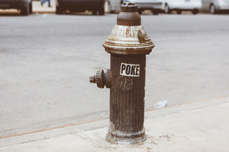 Close-up of fire hydrant on footpath