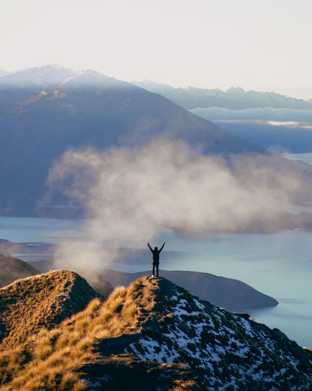 Wanaka Arms Outstretched Arms Raised Beauty In Nature Cloud - Sky Day Freedom Human Arm Idyllic Leisure Activity Lifestyles Mountain Mountain Peak Mountain Range Nature Non-urban Scene One Person Outdoors Real People Rock Royspeak Scenics - Nature Sky Standing Tranquil Scene Tranquility