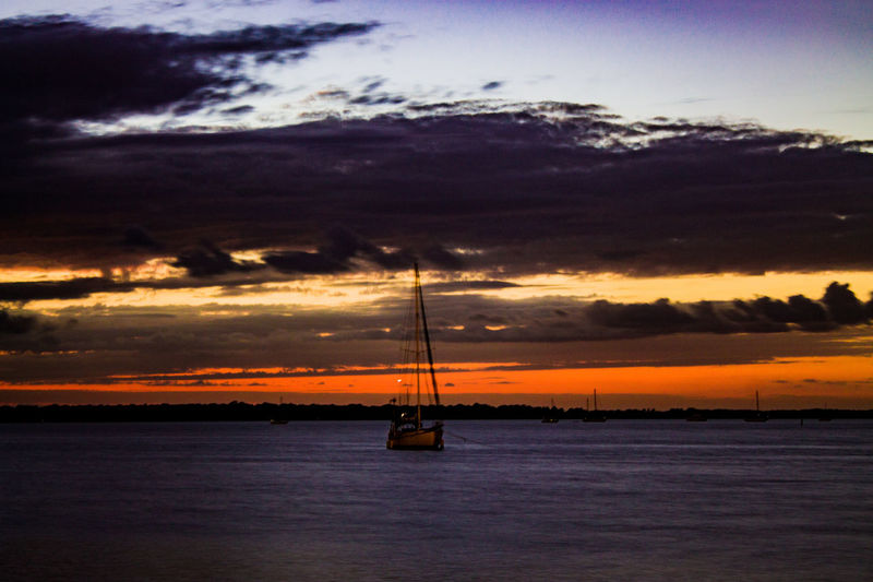 Sunset Sea Sky Cloud - Sky Beauty In Nature Water Scenics Nature Tranquility Tranquil Scene Horizon Over Water Dusk Reflection Dramatic Sky Transportation Nautical Vessel Outdoors Silhouette Mode Of Transport No People Sailboat Sky And Clouds Waves Tropical Florida