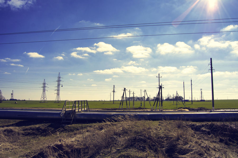 Belarus Nature Blue Cloud Cloud - Sky Connection Electricity  Electricity Pylon Exceptional Photographs EyeEm Nature Lover Field From My Point Of View Fuel And Power Generation Heating Main Landscape Landscape_photography Nature Photography No People Our Best Pics Urban Spring Fever Outdoors Power Line  Power Supply Landscapes With WhiteWall Sky Spring Landscape