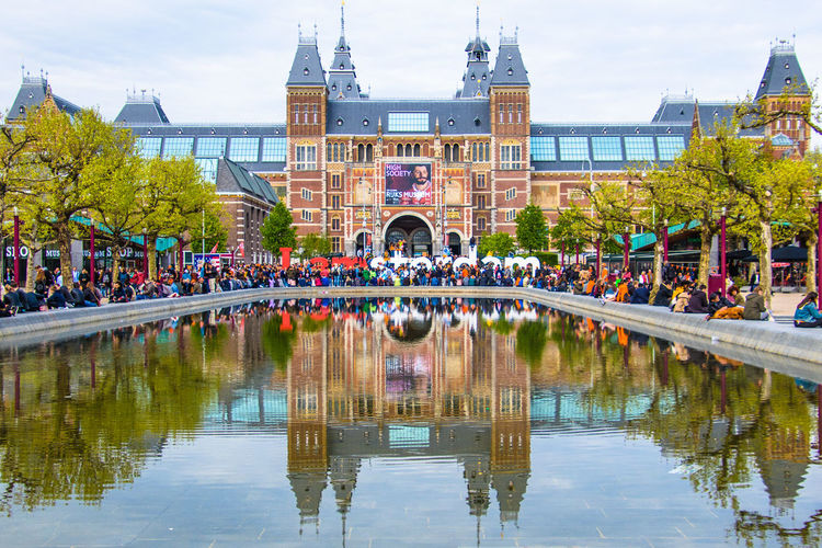 King's Day 2018 Koningsdag 2018 Architecture Bridge Bridge - Man Made Structure Building Building Exterior Built Structure City Day Group Of People Incidental People Large Group Of People Museumplein Nature Outdoors Plant Reflection Sky Tourism Travel Destinations Tree Water