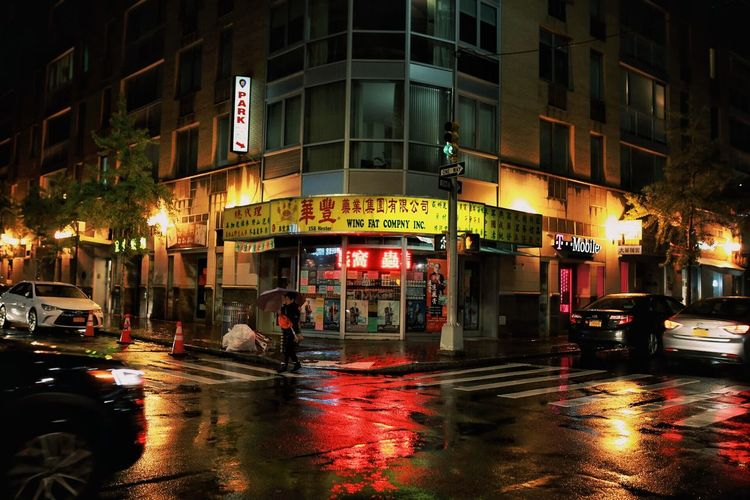 Building Exterior Architecture Built Structure City Street Night Illuminated Mode Of Transportation Transportation Building City Street Communication Motor Vehicle Land Vehicle Wet Water City Life Car Rain Outdoors