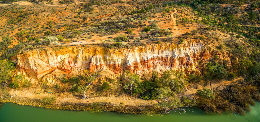 Colorful layers of sandstone erosion over Murray River near Berri, South Australia Australia Drone  Murray River Panorama Panoramic Riverland South Australia Aerial Aerial Landscape Aerial View Beauty In Nature Cliff Day Drone Photography Environment Eroded Erosion Geology Layers Mallee Mineral Nature No People Non-urban Scene Outdoors Physical Geography Plant Region River Rock Rock - Object Rock Formation Sandstone Scenics - Nature Solid Tranquil Scene Tranquility Travel Destinations Water Wilabalangaloo