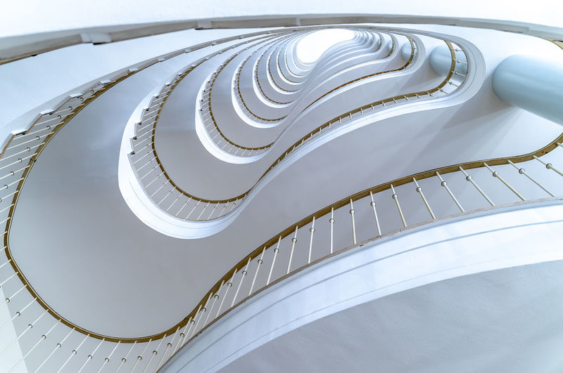 Krull&Krull Images Modern Futuristic Best Of Stairways No People Architecture High Angle View Built Structure Railing Indoors  Pattern Steps And Staircases Staircase Spiral White Color Metal Still Life Day Arts Culture And Entertainment Close-up Building Design Curve Directly Below My Best Photo