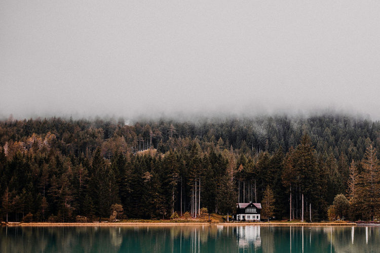 lonely house at the lake Autumn Lonely Quiet Toblach Toblacher See Cabin Fog Foggy Forest House Hut Lake Moody Scenics - Nature South Tyrol Tranquil Scene