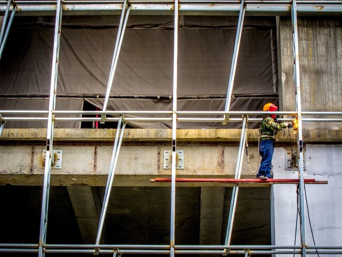 Low Angle View Of Worker At Construction Site