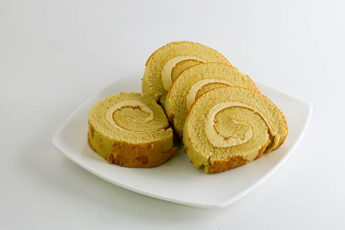 Coffee flavored roll cake on a plate Background Breakfast Brown Cake Cream Dessert Eating Food Fresh Jam Lunch Meal Plate Roll Set Snack Sweet Table
