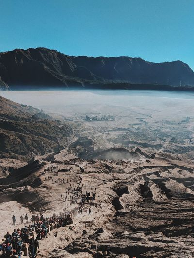 Mt Bromo East Java Mountain Blue Sky People Crowd Fog East Java INDONESIA Wonderful Indonesia Bromo Water Tranquil Scene Tranquility Sea Land Beauty In Nature Sky Scenics - Nature Mountain Mountain Range Nature Clear Sky Sand Outdoors Non-urban Scene