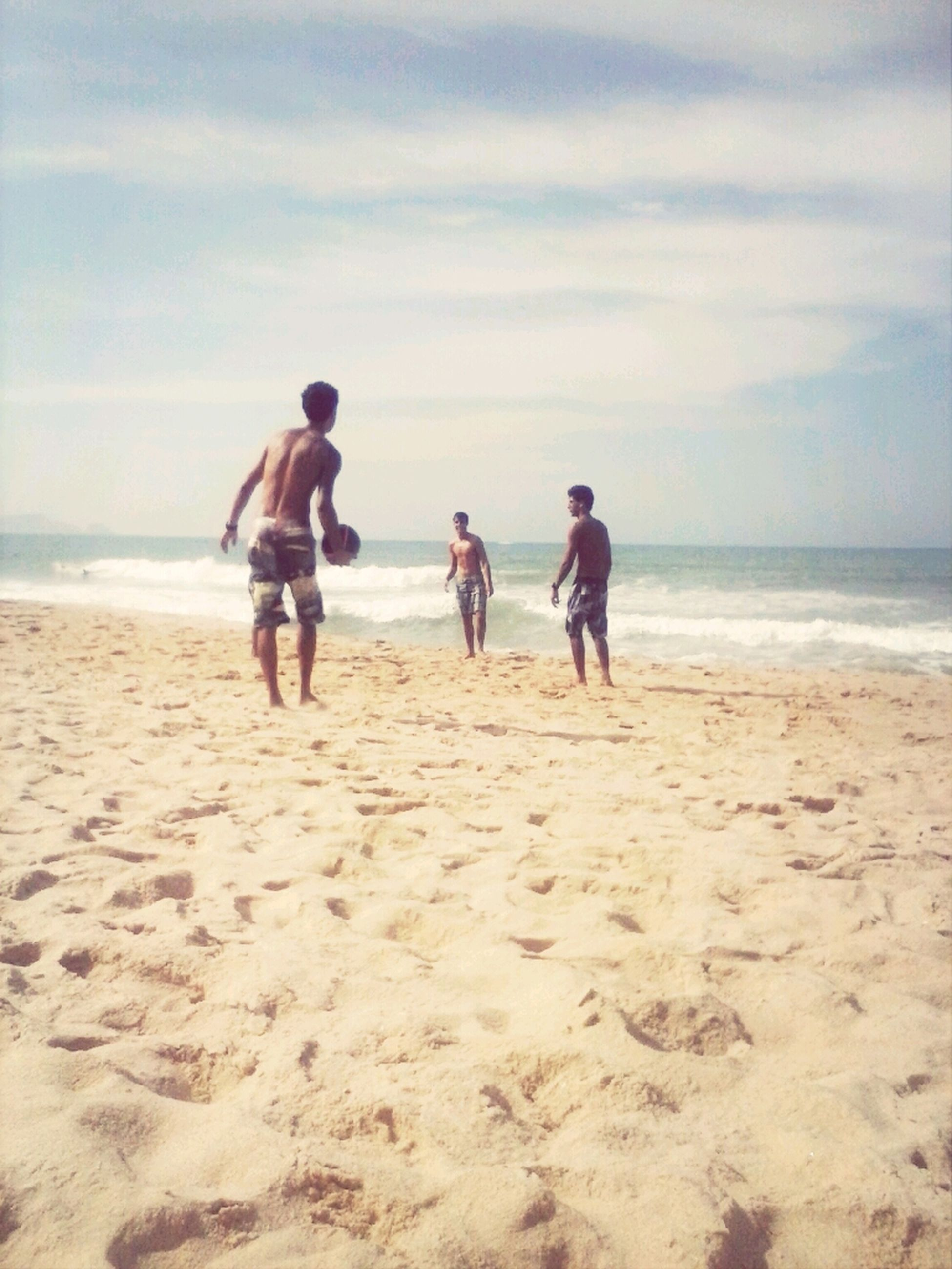 beach, sea, sand, horizon over water, shore, sky, lifestyles, leisure activity, full length, water, men, togetherness, vacations, person, walking, rear view, nature, bonding
