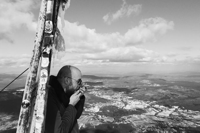 Gonzo calling home from the top of Klek mountain (elevation 1181 m). To get a good reception sometimes it's important to warm up smartphone a bit :) Croatia, 2017. Klek Mountain Croatia Summit Top Peak Sky Outdoors Calling Portrait Landscape Documentary Mobile Conversations