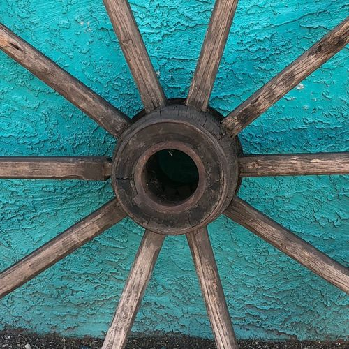 Spokes IPhone Architecture Wall Tourquise Wagon Wheel Wagonwheel Built Structure Wood - Material Architecture No People Pattern Low Angle View Close-up Day