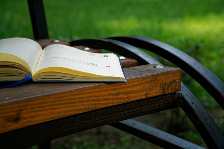 Notebook for ideas, educational concept Writing Bench Book Close-up Concept Day Education Educational Educational Time Focus On Foreground Grass Ideas Learning Nature No People NotePad Notebook Notes Open Outdoors Page Pages Paper Park Park - Man Made Space Park Bench Plant Publication Seat Selective Focus Still Life Study Studying Table Textbook Wood - Material