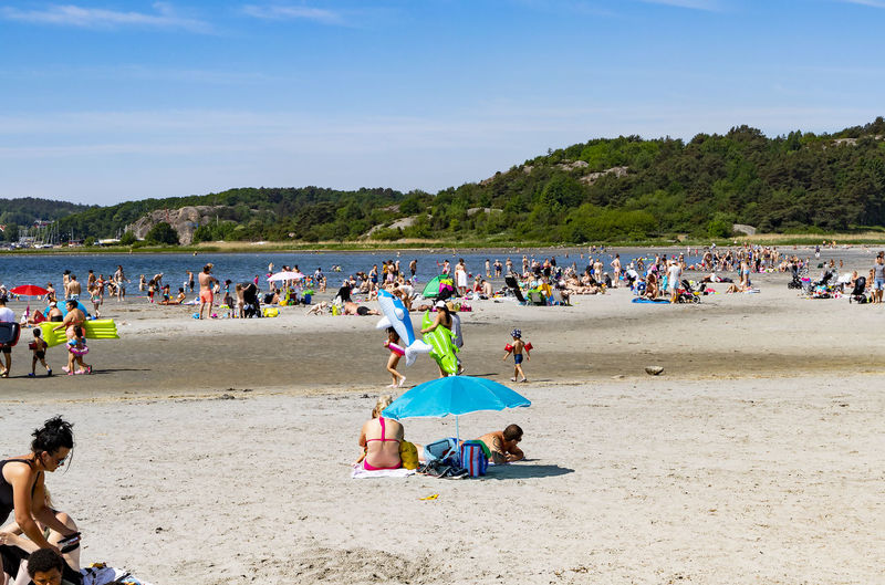 Summer #SummerTime People people and places Beach Beach Photography Goteborg Crowd Water Beach Togetherness Sea Sand Summer Relaxation Full Length Clear Sky Beach Umbrella Lounge Chair Sun Lounger Sand Pail And Shovel Parasol Sunbathing Beach Towel