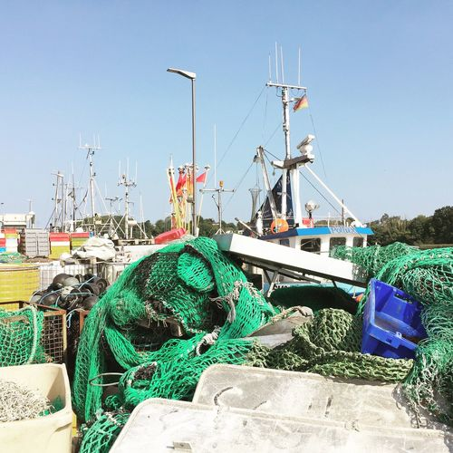 Fishing Net Transportation Nautical Vessel Mode Of Transport Clear Sky Moored Blue Harbor Sunny Day Multi Colored Calm Trawler Tranquility Commercial Dock No People Abundance Sea Animal Kappeln