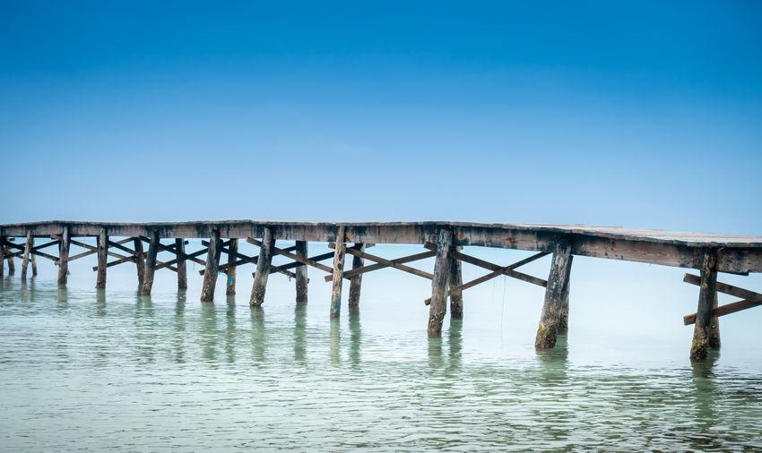 Pier Over Sea Against Clear Sky