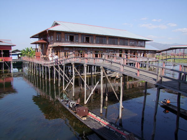 Walkway & Weaving Shed Architecture Blue Sky White Clouds Building Exterior Building On Stilts Built Structure Business Composition Inle Lake Lake Making A Living Myanmar Narrow Boat No People Outdoor Photography Shan State Sunlight And Shadows Tourism Tourist Attraction  Tourist Destination Traditional Building Traditional Crafts Traditional Culture Walkway Water Weaving