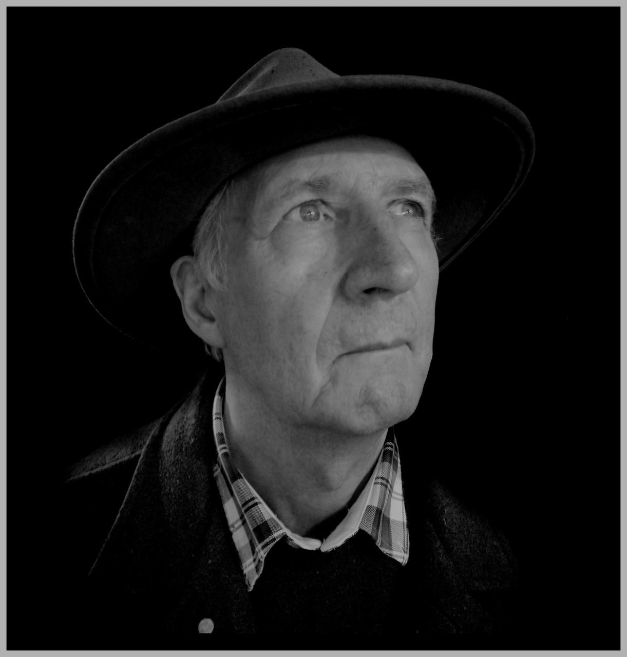 hat, headshot, real people, portrait, one person, looking at camera, black background, senior men, senior adult, lifestyles, cowboy hat, men, close-up, outdoors, day, people