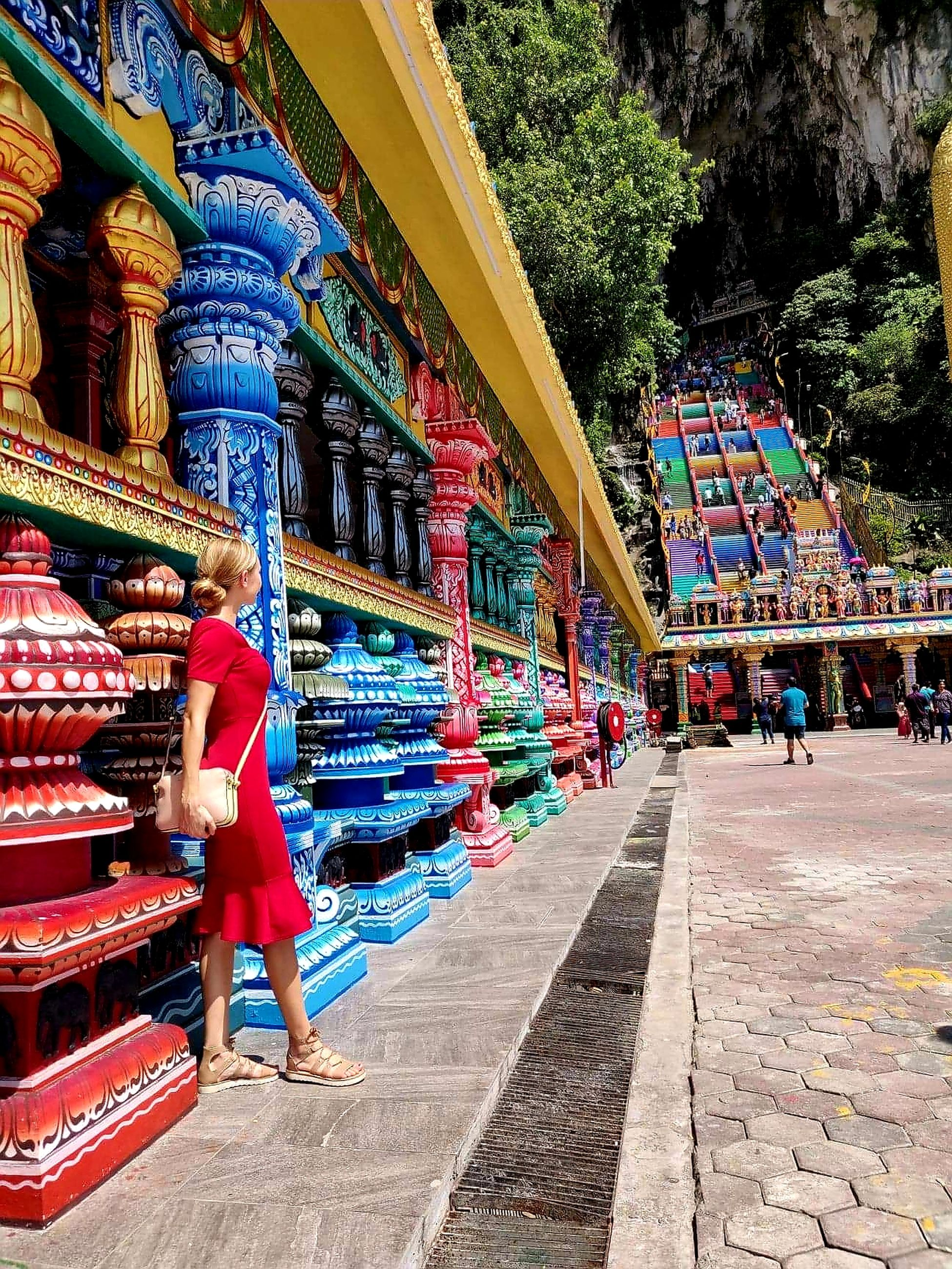 architecture, multi colored, built structure, art and craft, day, belief, religion, real people, place of worship, men, spirituality, incidental people, building exterior, building, adult, people, outdoors, creativity, lifestyles