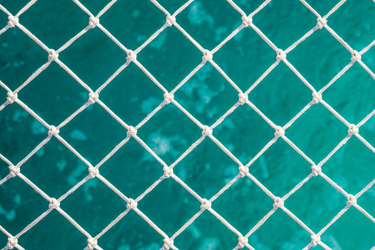 Backgrounds Full Frame Pattern Barrier Boundary No People Close-up Security Safety Protection Day Outdoors Nature Repetition Sunlight Textured  Blue Turquoise Colored Swimming Pool Crisscross Rope Tied Knot Caribbean Sea Catamaran Relaxation