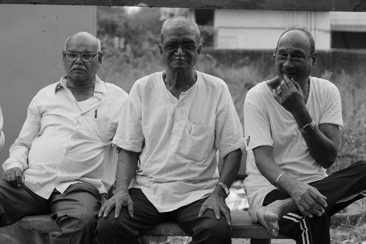 Portrait of old friends sitting outdoors