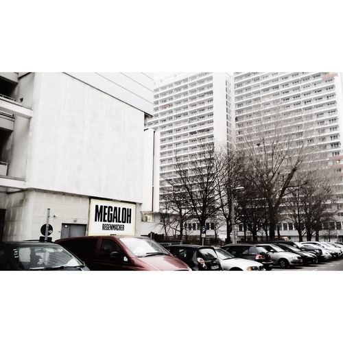 Mega New Berlin Billboard Cars Naturalized Urban Landscape Streetphoto_color Streetphotography Lerone-frames Mitte Then There Were Trees Facades Façade Highrise Housing White Album
