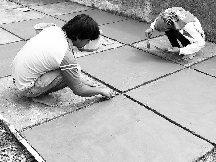 People Working On Tiles
