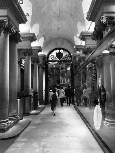 Palau Robert Eye4photography  EyeEm Gallery Iphonephotography Iphoneonly IPhoneography Black & White Black And White Blackandwhite BW_photography Bw_collection Streetphoto_bw Streetphotography Reflection Perspective Architecture Built Structure Real People Building Men The Way Forward Building Exterior Direction Architectural Column Group Of People