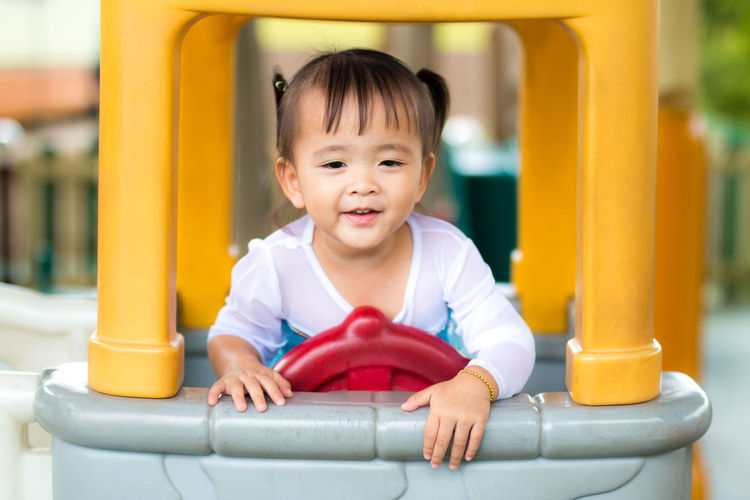 Cheerful Childhood Close-up Cute Day Full Length Happiness Innocence One Person Outdoors People Playground Playing Real People Sitting Smiling Toy Car