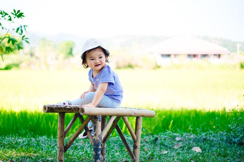 Portrait of cute boy on field