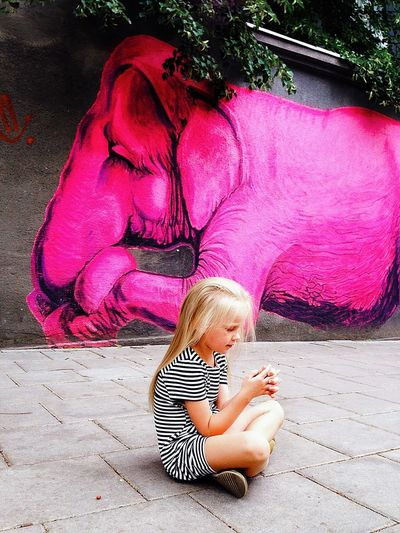 It's always world... Elephant PinkElephant Pink Color Pink Happy People One Person Child Real People Childhood Women Full Length Lifestyles Day Females Baby Girls Relaxation Offspring Human Foot Adult Innocence Blond Hair Sitting Dress Happiness Portrait Long Hair Hair Emotion Summer Road Tripping