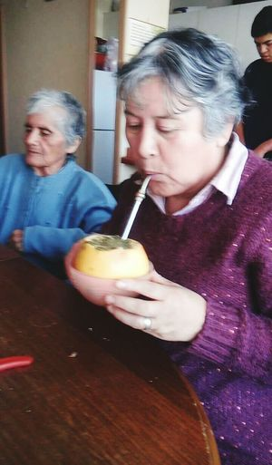 Mi madre y mi abuela <3 Indoors  Lifestyles Food And Drink Person Leisure Activity Side View Togetherness Looking At Camera Young Adult Holding Freshness Indulgence Focus On Foreground rico matesito
